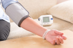 Checking blood pressure at home Stock Images