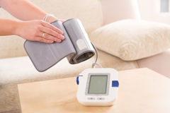 Checking blood pressure at home Stock Photography