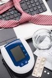 Checking blood pressure in office Royalty Free Stock Image