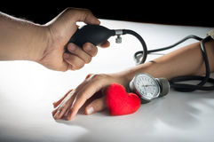 Checking the blood pressure the patient. Royalty Free Stock Photography