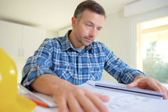 Checking building plans before starting Royalty Free Stock Photography