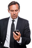 Checking business messages. Stock Photography