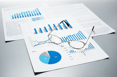 Checking business reports. Graphs and charts. Royalty Free Stock Photos