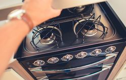 Camper RV Propane Stove. Checking on Camper RV Propane Stove. Cooking While Travel Theme Stock Photos