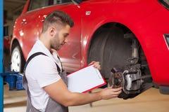 Checking a car brakes Royalty Free Stock Photo