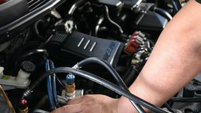 Checking a car engine at garage stock footage