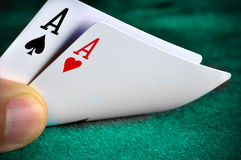 Checking cards. A man playing poker and checking his cards Royalty Free Stock Image
