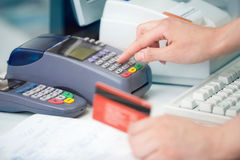 Checking the Credit Card. Reading the Credit card at the Credit Card Reader Royalty Free Stock Photo