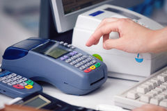 Checking the Credit Card. Reading the Credit card at the Credit Card Reader Royalty Free Stock Images