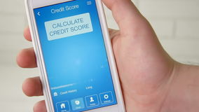 Checking credit score on smartphone using application. The result is EXCELLENT