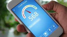 Checking credit score on smartphone using application. The result is GOOD stock video