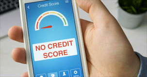 Checking credit score on smartphone using application. The result is NO CREDIT SCORE stock video footage