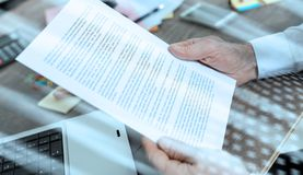 Checking a document (Lorem ipsum text); light effect. Checking a document in office (Lorem ipsum text); light effect royalty free stock photography