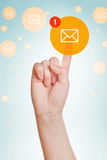 Checking E-mail Inbox. Caucasian female hand pushing e-mail icon on virtual display royalty free stock images