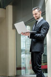 Checking e-mail. Young and successful businessman on the laptop Stock Image