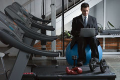 Checking Email At The Gym Royalty Free Stock Image
