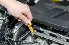 Checking for engine oil on a car Stock Image