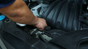 Checking engine oil Royalty Free Stock Image
