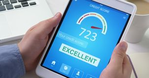 Checking excellent credit score on digital tablet