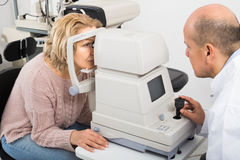 Checking eyesight in clinic Stock Photography