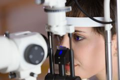 Checking eyesight in a clinic. Ophthalmology. Medicine and health concept. Royalty Free Stock Photos