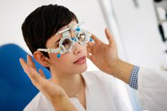 Checking eyesight in a clinic. Ophthalmology. Medicine and health concept. Royalty Free Stock Image