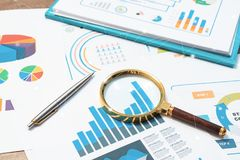 Checking financial reports. Graphs and charts. Documents and mag royalty free stock image