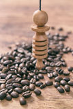 Checking food with pendulum. Using pendulum over coffee beans to check its quality Royalty Free Stock Photography