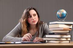 Checking the globe a teenage girl doing homework Stock Images