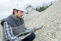 Checking the gravel quality. Work stock photo