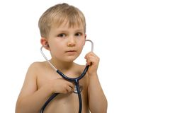 Checking For A Heartbeat. Little blond boy with look of anticipation, checking his own heartbeat with a stethoscope Royalty Free Stock Photo