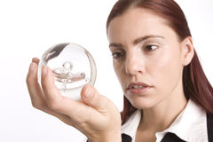 Checking her crystal ball Stock Images