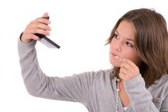 checking her makeup Стоковая Фотография RF