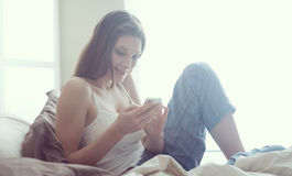 Checking her texts Royalty Free Stock Photo