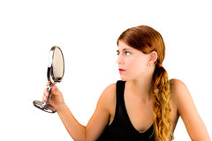 Checking herself in the mirror Royalty Free Stock Images
