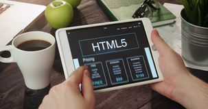 Checking html5 info using digital tablet stock video footage