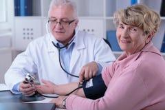 Checking the hypertension Stock Photos