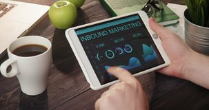Checking inbound marketing records using digital tablet stock footage