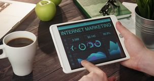 Checking internet marketing info using digital tablet stock footage