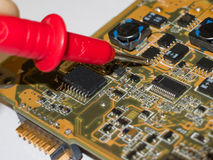 Checking the laptop`s motherboard. Checking the components of the laptop motherboard with a multimeter royalty free stock photography