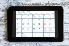 Checking monthly activities in the calendar in the tablet Royalty Free Stock Photo