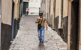 Checking my cellphone. A young Italian guy walking on the streets of Italy and checking his cellphone for new messages Royalty Free Stock Photo