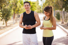 Checking my fitness app on a phone Royalty Free Stock Photography