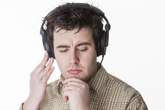 Checking the next sound. Thinking about the next track or finding a bug in the sound Royalty Free Stock Photography