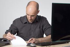 Checking the notes Stock Images