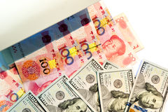 Checking one hundred dollar and yuan banknotes with ultraviolet Stock Images