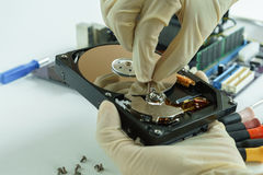Checking Opened Hard Disk Drive in hand Stock Images
