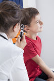 Checking by otoscope Royalty Free Stock Images