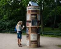 Checking out lending library in a German park Stock Image