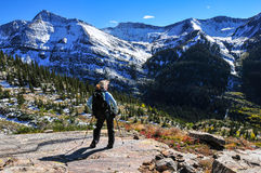 Checking it out. Mature woman trekking alpine terrain Stock Images